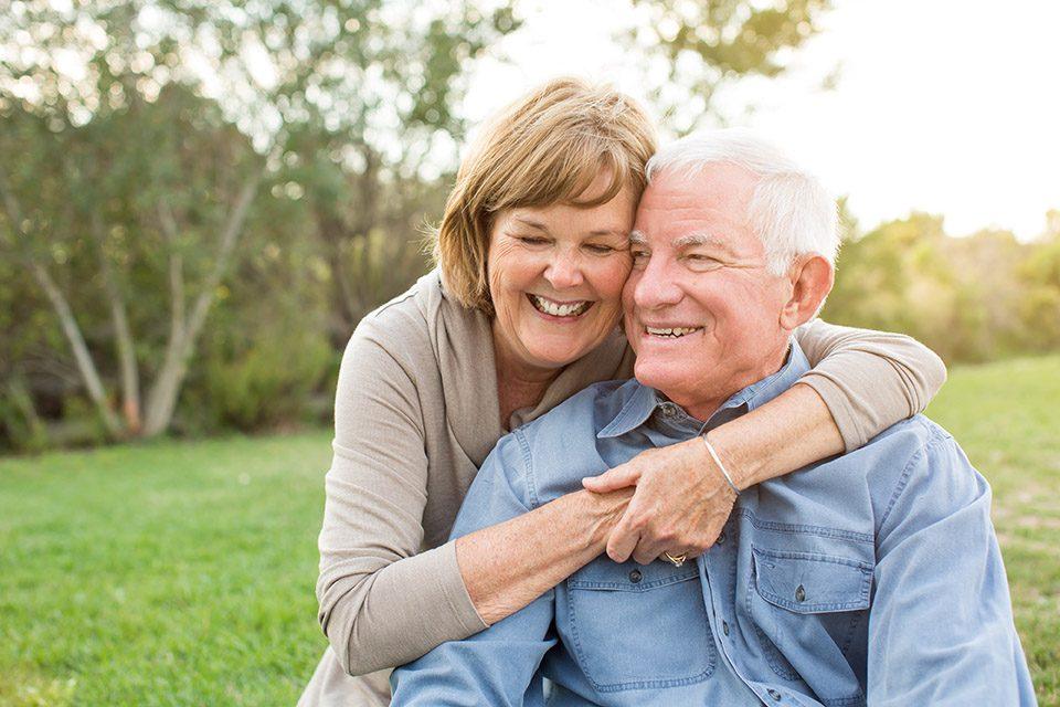 Eldery people hugging and smiling